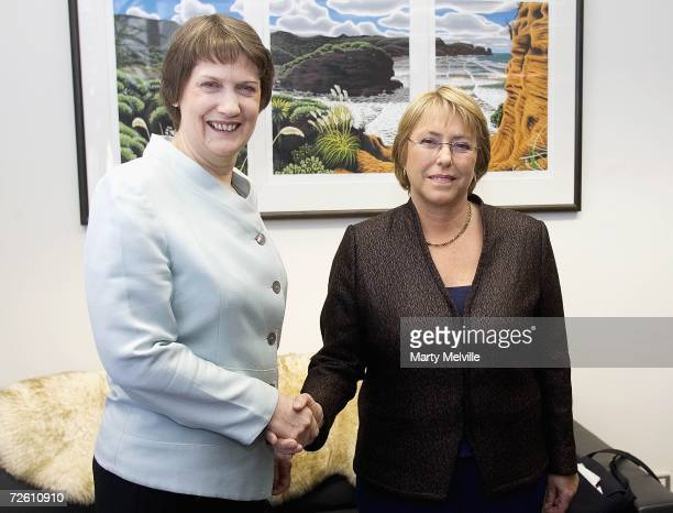 President Michelle Bachelet of Chile shakes hand with Prime Minister of New Zealand Helen Clark during her visit to New Zealand's Parliament...