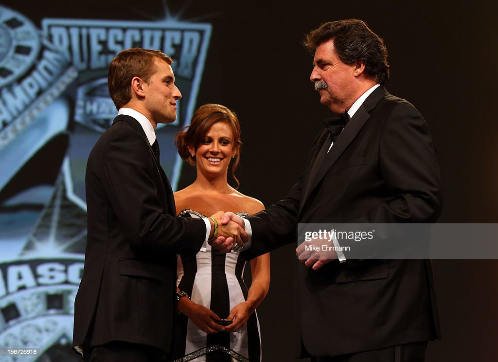 President Mike Helton (R) presents Camping World Truck Series Champion James Buescher (L) with a ring during the NASCAR Nationwide Series And Camping World Truck Awards Banquet at Loews Miami Beach on November 19, 2012 in Miami Beach, Florida.