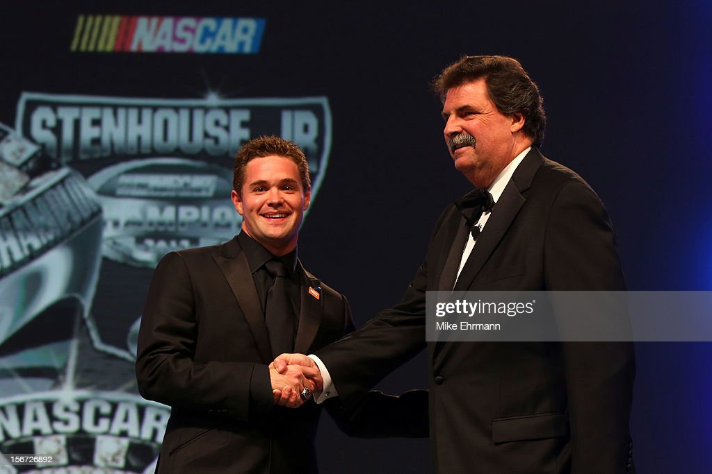 President Mike Helton (R) presents Nationwide Series Champion Ricky Stenhouse Jr. with a ring during the NASCAR Nationwide Series And Camping World Truck Awards Banquet at Loews Miami Beach on November 19, 2012 in Miami Beach, Florida.