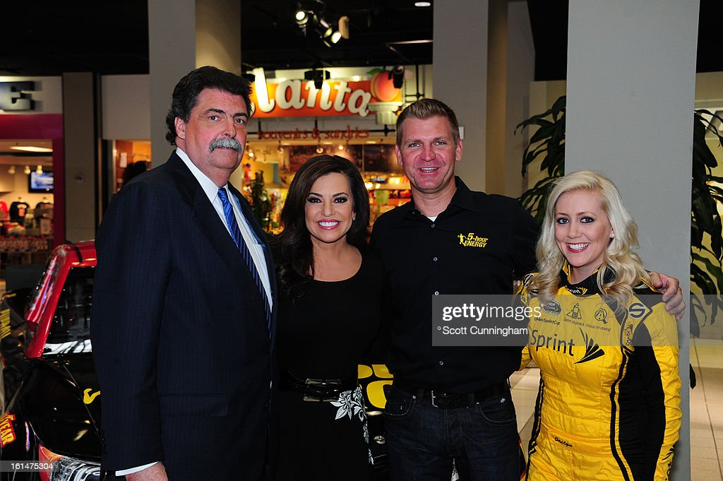 President <a gi-track='captionPersonalityLinkClicked' href=/galleries/search?phrase=Mike+Helton+-+Racing+Executive&family=editorial&specificpeople=226522 ng-click='$event.stopPropagation()'>Mike Helton</a>, Robin Meade of CNN Headline News, <a gi-track='captionPersonalityLinkClicked' href=/galleries/search?phrase=Clint+Bowyer&family=editorial&specificpeople=537951 ng-click='$event.stopPropagation()'>Clint Bowyer</a>, driver of the #15 5-hour Energy Toyota, and Miss Sprint Cup Jaclyn Roney (L-R) pose for a photograph during the Road to Daytona Fueled By Sunoco at CNN Center on February 11, 2013 in Atlanta, Georgia.