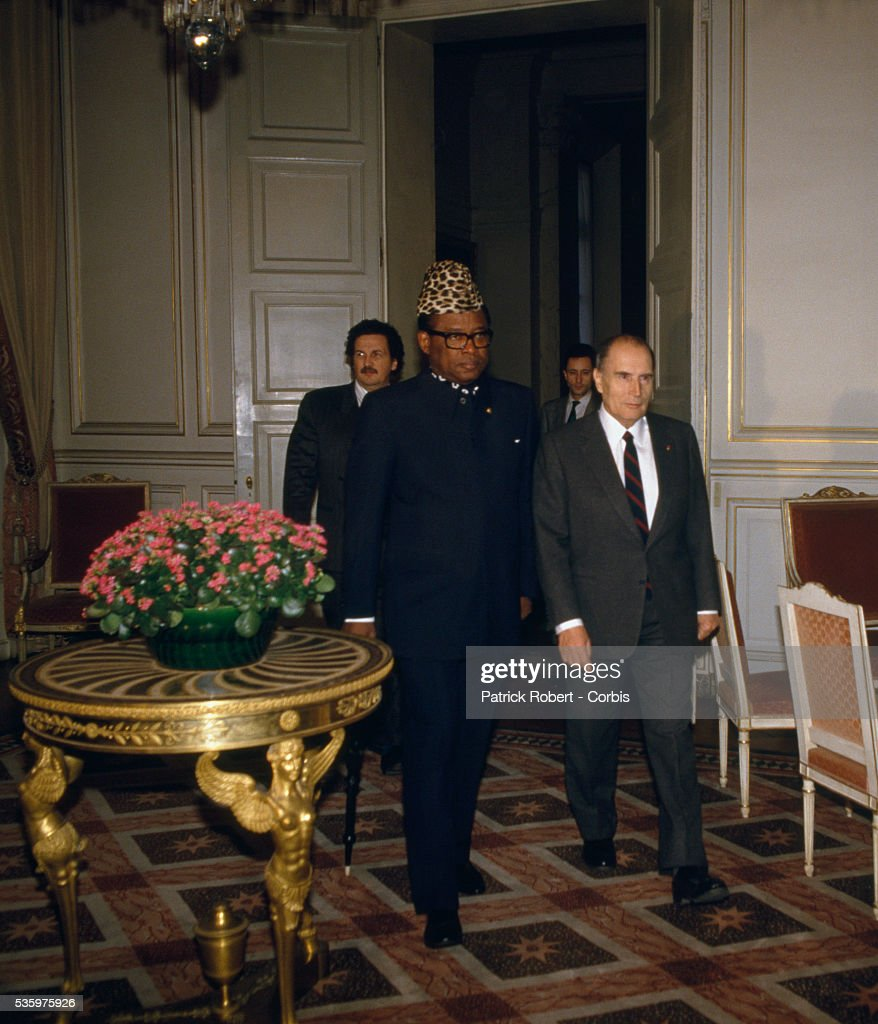 President Mobutu Sese Seko of Zaire meets with French president Francois Mitterrand in Paris. Mitterrand's son, Jean-Christophe, official advisor to Africa, follows behind.