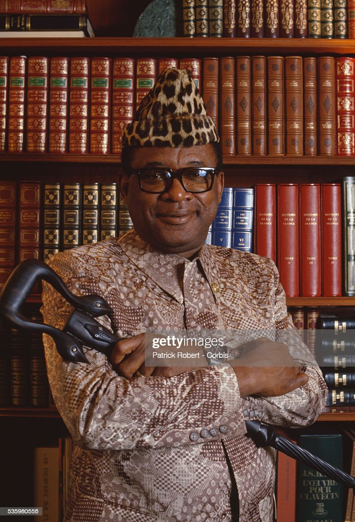 President Mobutu Sese Seko of Zaire poses in front of the bookshelves in his Avenue Foch office in Paris. Mobutu (1930-1997) created a nationalistic state in Zaire, later the Democratic Republic of the Congo, and built his personal wealth on foreign aid and corruption.