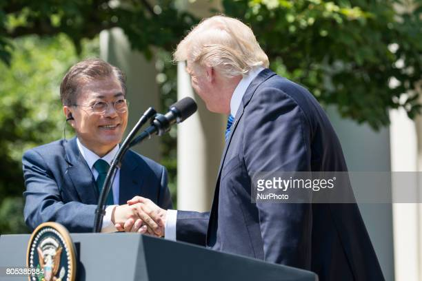 President Moon of the Republic of Korea and US President Trump shake hands during their joint press conference in the Rose Garden of the White House...