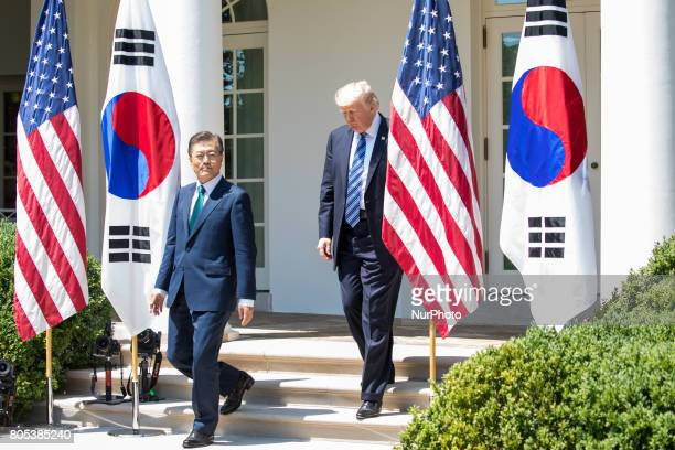 President Moon of the Republic of Korea and US President Trump walk from the Oval Office for their joint press conference in the Rose Garden of the...