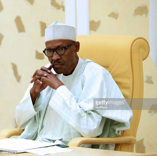 President Muhammadu Buhari looks on after he signs the Instrument of Ratification for International Agreements between Nigeria and Other Countries in...