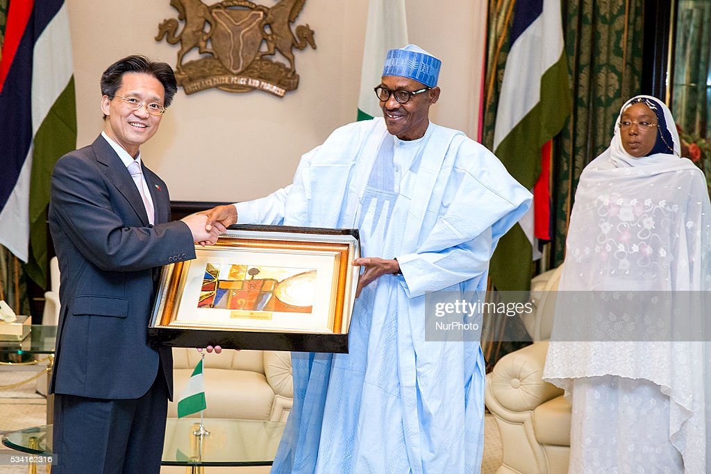 President <a gi-track='captionPersonalityLinkClicked' href=/galleries/search?phrase=Muhammadu+Buhari&family=editorial&specificpeople=2638261 ng-click='$event.stopPropagation()'>Muhammadu Buhari</a> receives a gift, in farewell audience of H.E. Gu Xiaojie, Outgoing Ambassador of Peoples Republic of China to Nigeria in Abuja, 25th May 2016