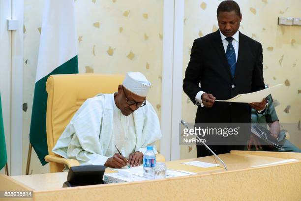 President Muhammadu Buhari signs Instrument of Ratification for International Agreements between Nigeria and Other Countries with Minister of Justice...