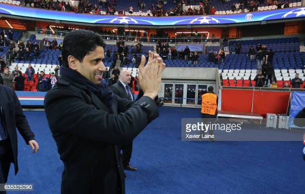 President Nasser AlKhelaifi of Paris SaintGermain celebrates the victory with fan during the UEFA Champions League Round of 16 first leg match...