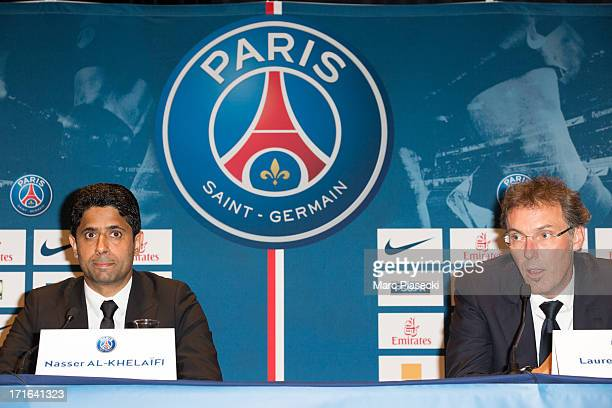President Nasser AlKhelaifi of Paris SaintGermain introduces the new coach of French L1 football club Paris SaintGermain Laurent Blanc during his...