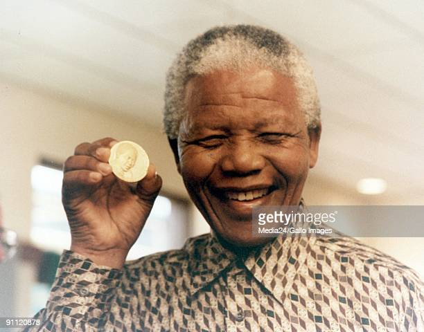 President Nelson Mandela at the South African Mint where the first presidential coin was launched It depicts the inauguration of President Mandela in...