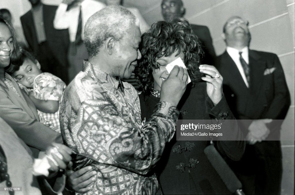 President Nelson Mandela being like a concerned parent wiping the tears of a very emotional Whitney Houston where she met Mr. Mandela on the steps of the Union Buildings in Pretoria.