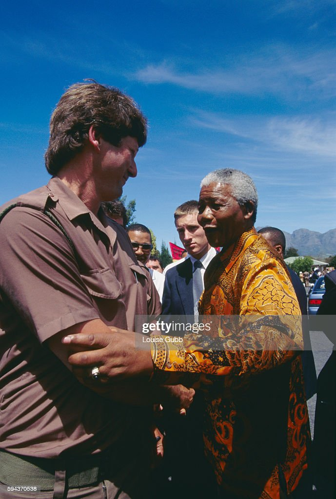 President Nelson Mandela greets a prison worker who served while Mandela was incarcerated at Victor Verster Prison Former President of South Africa...