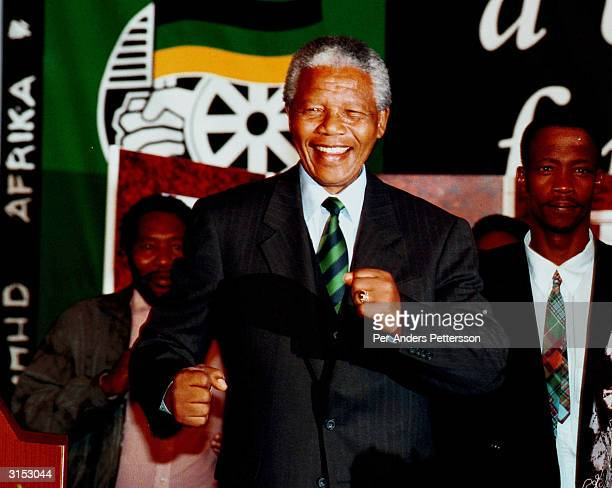 President Nelson Mandela of South Africa celebrates his historic election win at the ANC victory party on May 2 1994 at Carlton Hotel in Johannesburg...