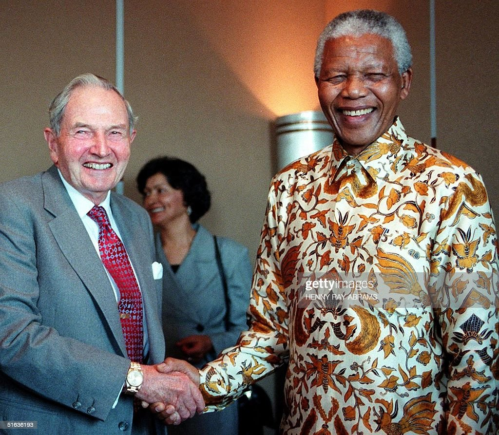 http://media.gettyimages.com/photos/president-nelson-mandela-of-south-africa-shakes-hands-with-david-a-picture-id51636193