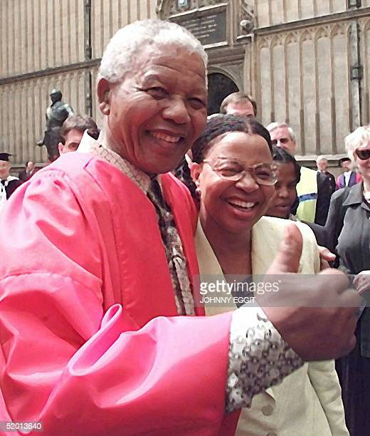 President Nelson Mandela of South Africa with Graca Machel widow of former Mozambique president Samora Machel gives the thumbs up after a ceremony of...