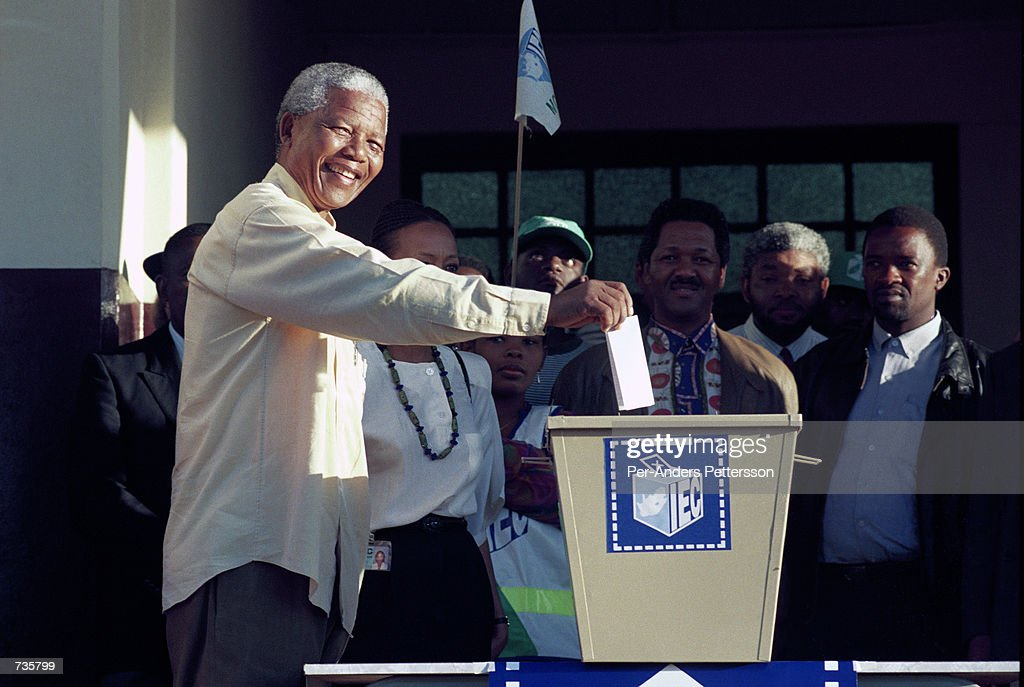 President <a gi-track='captionPersonalityLinkClicked' href=/galleries/search?phrase=Nelson+Mandela&family=editorial&specificpeople=118613 ng-click='$event.stopPropagation()'>Nelson Mandela</a> votes at a small station on April 28, 1994 outside Durban, Natal during the historic democratic election February 28, 1994 in South Africa.