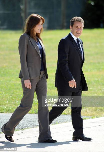 President Nicolas Sarkozy and first lady Carla BruniSarkozy of France await the arrival by plane of freed hostage Ingrid Betancourt at the military...