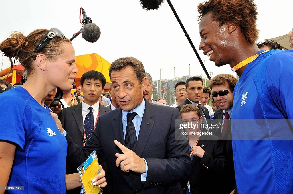 President Nicolas Sarkozy meets the French athletes at the Olympic Village in Beijing China On August 08 2008Left to Right Laure Manaudou Nicolas...