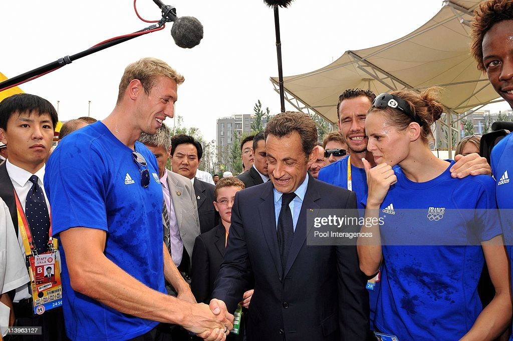 President Nicolas Sarkozy meets the French athletes at the Olympic Village in Beijing China On August 08 2008Left to Right Alain Bernard Nicolas...