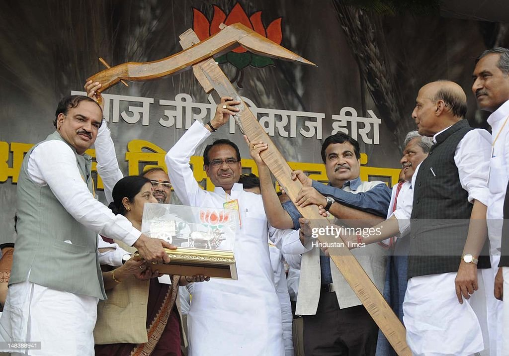 BJP President Nitin Gadkari along with former President Rajnath Singh, leader of opposition in Loksabha Sushma Swaraj, Annanth Kumar and others presents a 'plough' to Madhya Pradesh chief minister Shivraj Singh Chouhan during the Atal Kisan Mahapanchayat, or gethering of farmers, at the Jumboree ground on July 15, 2012 in Bhopal, India. Farmers gather at the Mahapanchayat was to celebrate the chief minister's decision to give zero-interest loans to farmers.