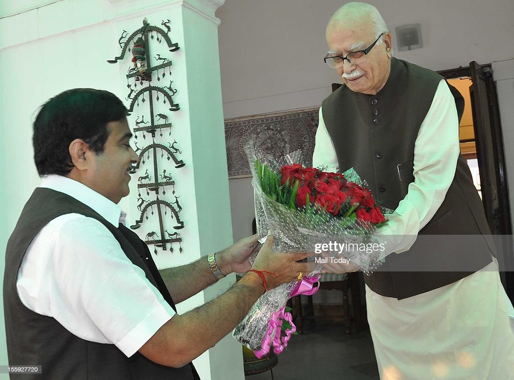 BJP President Nitin Gadkari greets senior BJP leader LK Advani on his birthday in New Delhi on Thursday.