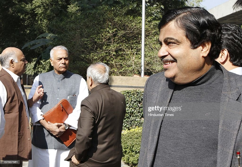 BJP President Nitin Gadkari looks to his party leader Yashwant Sinha after BJP Parliamentary party leaders meeting at Parliament house Annexe on November 27, 2012 in New Delhi, India.