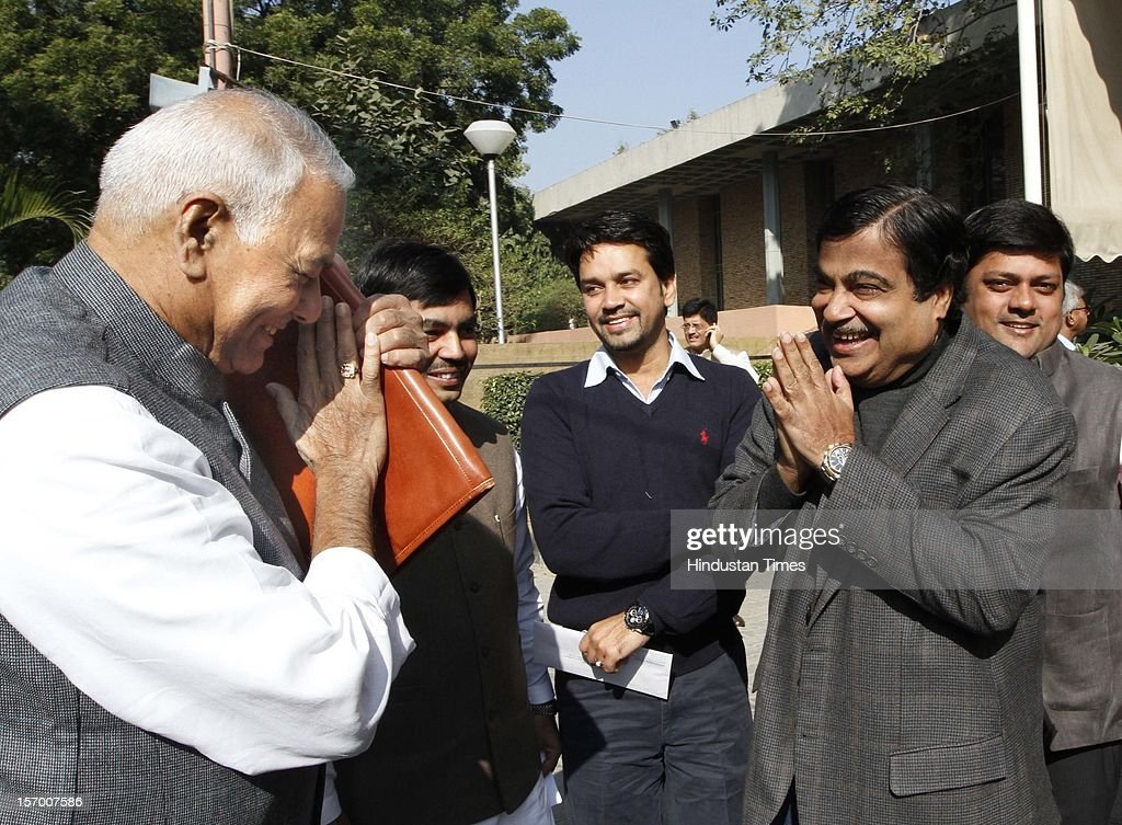 BJP President Nitin Gadkari with Yashwant Sinha after BJP Parliamentary party leaders meeting at Parliament house Annexe on November 27, 2012 in New Delhi, India.