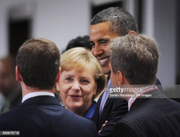 President Obama and Chancellor of Germany Angela Merkel share a joke with Russian President Dmitry Medvedev as they arrive at the G8 Summit in...