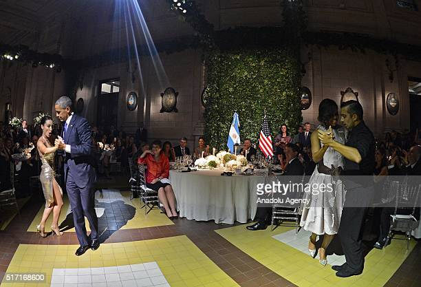 President Obama dances tango with a dancer as first lady Michelle Obama dances with another dancer nearby during the official state dinner at the...