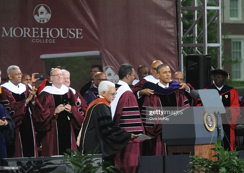 President Obama is presented with an honorary Doctor Of Laws degree by Dr. Willis Braswell Shaftall (L), Dr. John Silvanus Wilson, Jr., (2nd Left) and Robert C. Davidson during Morehouse College 2013 commencement at Morehouse College on May 19, 2013 in Atlanta, Georgia.