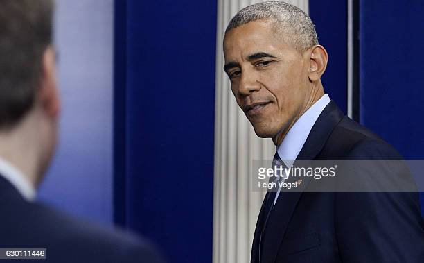 President Obama walks out of the Brady Press Room after holding a yearend press conference addressing email hacking and cyber security at The White...