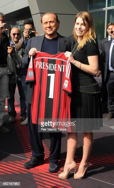 President of AC Milan Silvio Berlusconi and Barbara Berlusconi pose for a photo before the visit at AC Milan's Casa Milan on June 6 2014 in Milan...