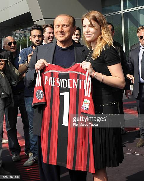 President of AC Milan Silvio Berlusconi and Barbara Berlusconi pose for a photo before the visit at AC Milan's Casa Milan on June 6 2014 in Milan...