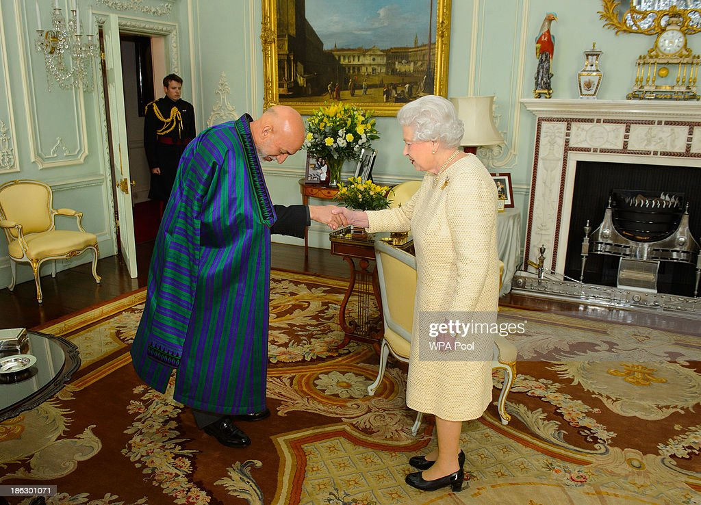 President of Afghanistan Hamid Karzai attends an audience with Queen Elizabeth II at Buckingham Palace on October 30 2013 in London England The...