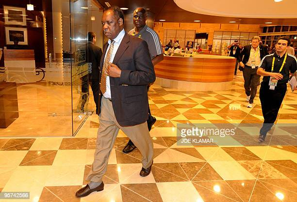 President of African Football Confederation Issa Hayatou is followed by member of Cup for African Nations organising comittee and Congolese football...