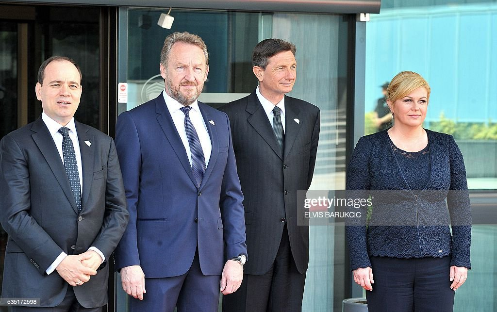 President of Albania Bujar Nishani, Member of the Tripartite Bosnian Presidency Bakir Izetbegovic, President of Slovenia Borut Pahor, Croatian President Kolinda Grabar-Kitarovic pose at Bosnia and Herzegovina's National Assembly in Sarajevo, on May 29, 2016. Heads of western Balkan nations meet for an annual summit during which they will discuss regional cooperation. / AFP / ELVIS