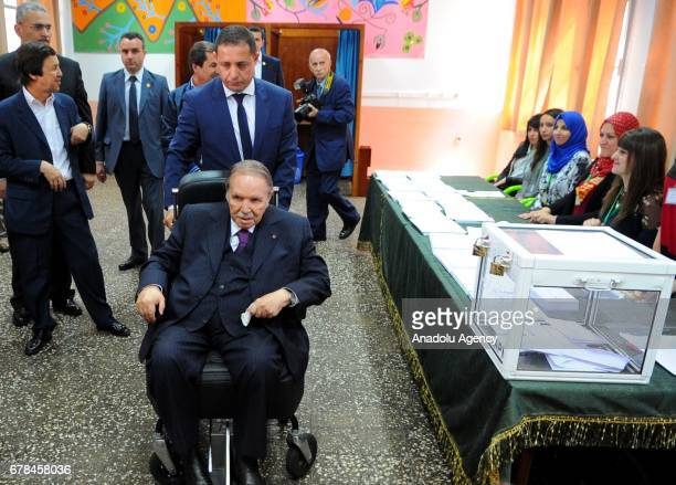 President of Algeria Abdelaziz Bouteflika arrives to cast his ballot to elect members of the countrys 462seat parliament in Algiers Algeria on May 4...