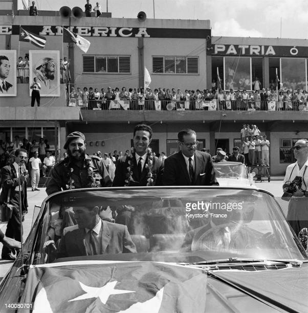 President of Algerian council Ahmed Ben Bella in the official convertible car with Fidel Castro and the president of Cuba Osvaldo Dorticos on October...
