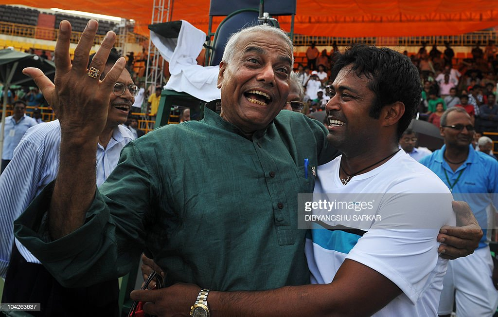 President of All India Tennis Association (AITA) Yashwant Sinha (L) congratulates Indian tennis player Leander Paes (R) after India player Rohan Bopanna (unseen) won the final reverse single to Brazilian opponent Ricardo Mello for the Davis Cup World Group play-off tie between India and Brazil at the Nungambakkam tennis stadium in Chennai on September 19, 2010. Indian won 6-3, 7-6 (7/2), 6-3. AFP PHOTO/Dibyangshu SARKAR