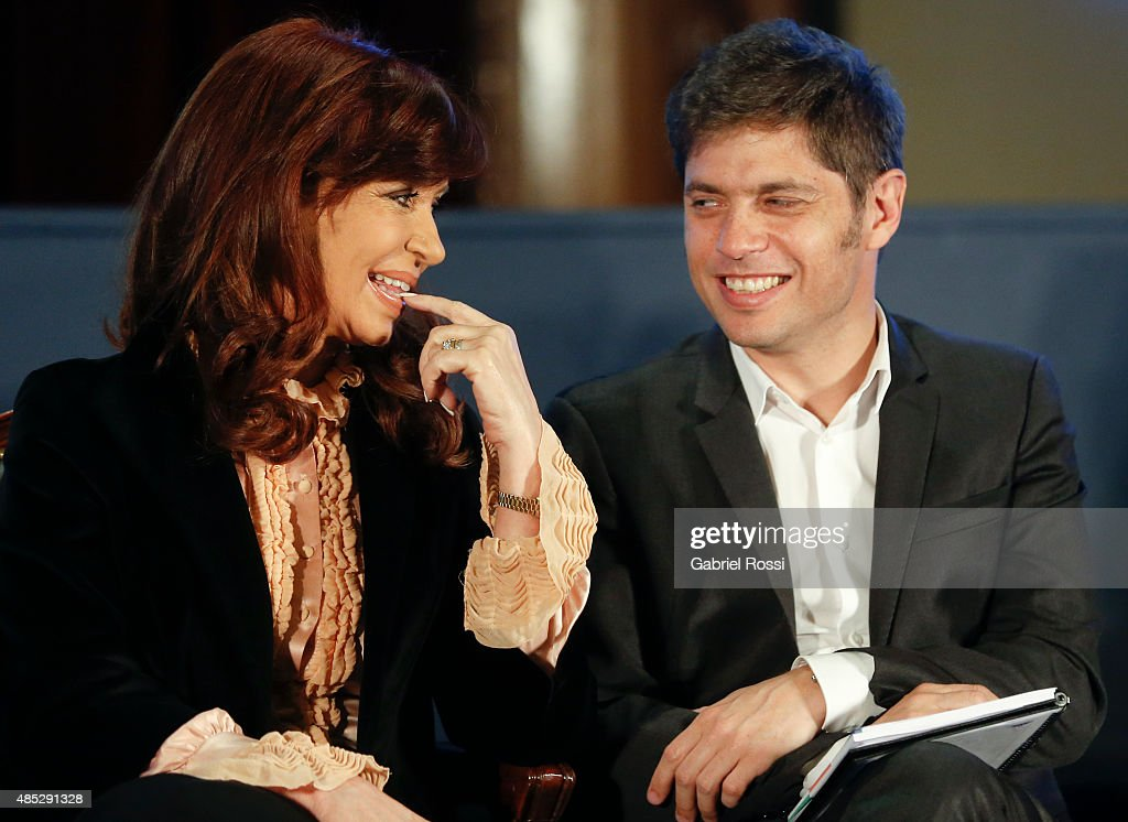 President of Argentina <a gi-track='captionPersonalityLinkClicked' href=/galleries/search?phrase=Cristina+Fernandez+de+Kirchner&family=editorial&specificpeople=565499 ng-click='$event.stopPropagation()'>Cristina Fernandez de Kirchner</a> and Economy Minister <a gi-track='captionPersonalityLinkClicked' href=/galleries/search?phrase=Axel+Kicillof&family=editorial&specificpeople=9189054 ng-click='$event.stopPropagation()'>Axel Kicillof</a> smile during a ceremony commemorating the 161st anniversary of the Buenos Aires Stock Exchange on August 26, 2015 in Buenos Aires, Argentina.