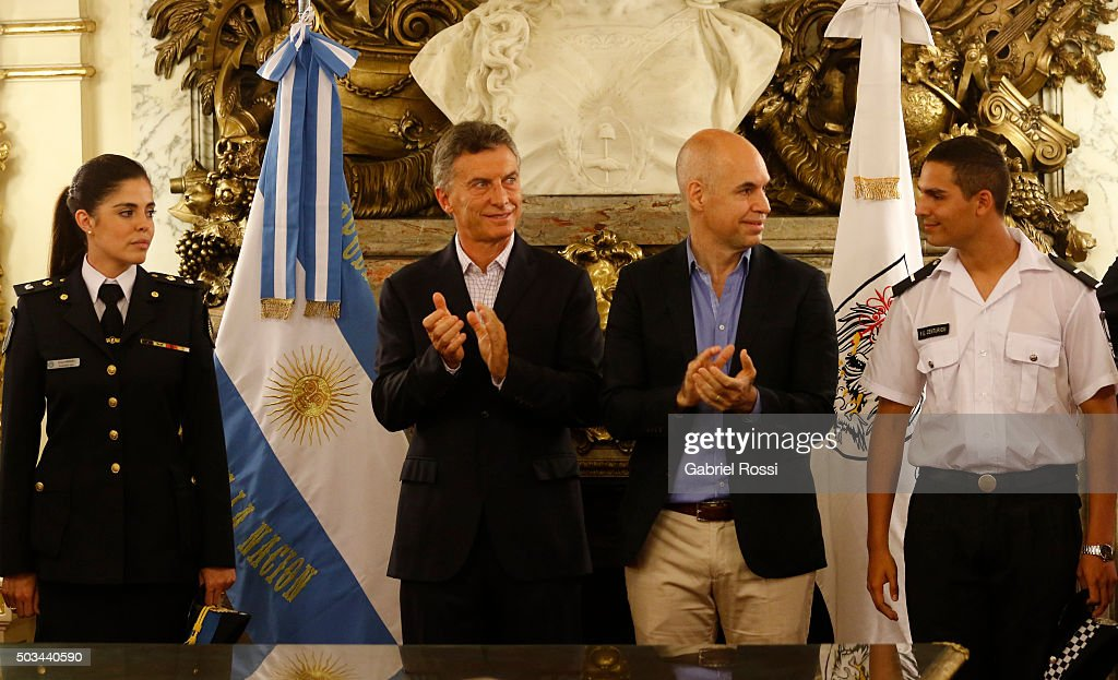 President of Argentina Mauricio Macri and Mayor of Buenos Aires Horacio Rodriguez Larreta clap their hands during a conference to announce the transference of more than 21,000 Federal Police (PFA) officers to the Buenos Aires City government and to leave the PFA in charge of fighting federal crime, including drug trafficking and human trafficking on January 05, 2016 in Buenos Aires, Argentina.