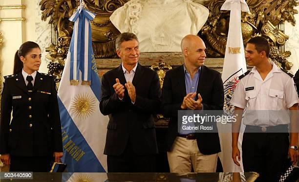 President of Argentina Mauricio Macri and Mayor of Buenos Aires Horacio Rodriguez Larreta clap their hands during a conference to announce the...