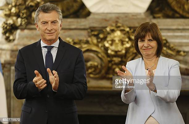 President of Argentina Mauricio Macri and Minister of National Security Patricia Bullrich applause during an official ceremony to promote members of...