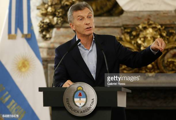 President of Argentina Mauricio Macri gestures during a press conference to announce the opening of biddings for commercial air transport allowing...