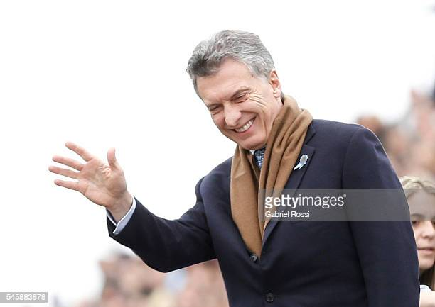 President of Argentina Mauricio Macri greets during Argentina Bicentennial Celebrations at Libertador Avenue on July 10 2016 in Buenos Aires Argentina