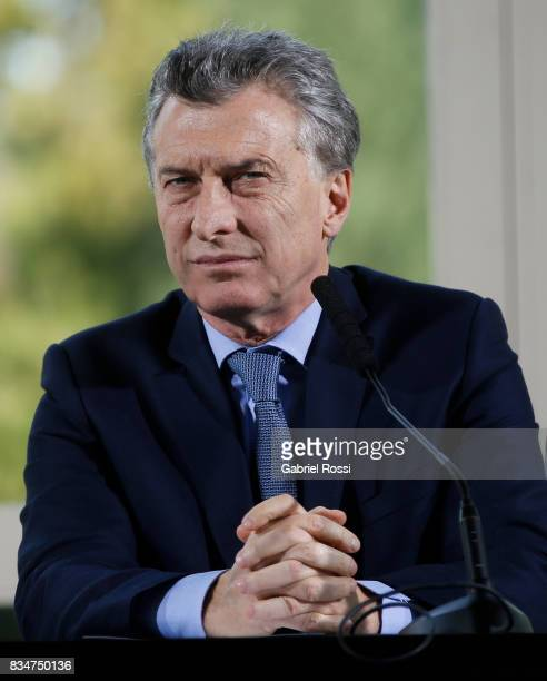 President of Argentina Mauricio Macri looks on during a press conference as part of the official visit of Jim Yong Kim President of The World Bank at...