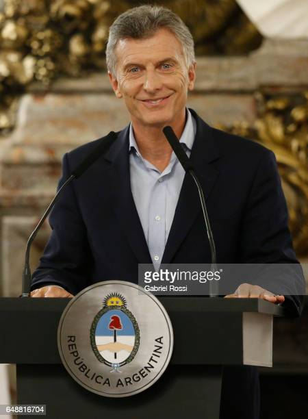 President of Argentina Mauricio Macri smiles during a press conference to announce the opening of biddings for commercial air transport allowing low...