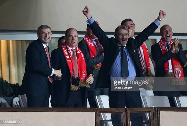 President of AS Monaco Dmitri Rybolovlev Prince Albert II of Monaco President of French Ligue Frederic Thiriez celebrate Monaco's victory after the...