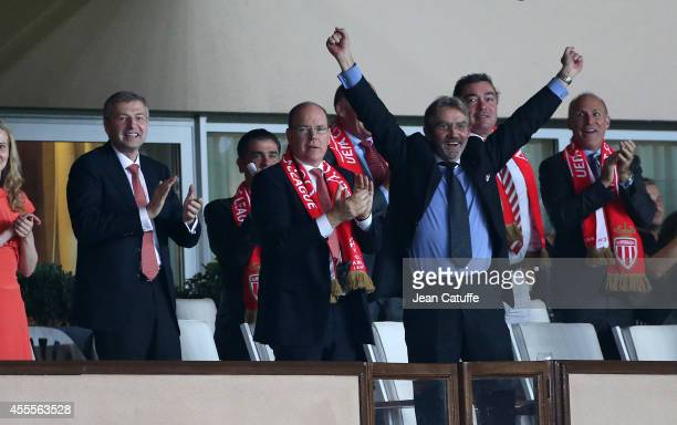 President of AS Monaco Dmitri Rybolovlev Prince Albert II of Monaco President of French Ligue Frederic Thiriez celebrate Monaco's victory after the...