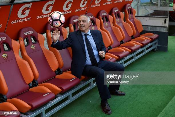 President of AS Roma James Pallotta poses for a photo with a soccer ball to reporters during the Serie A Week 38 match between AS Roma and Genoa CFC...
